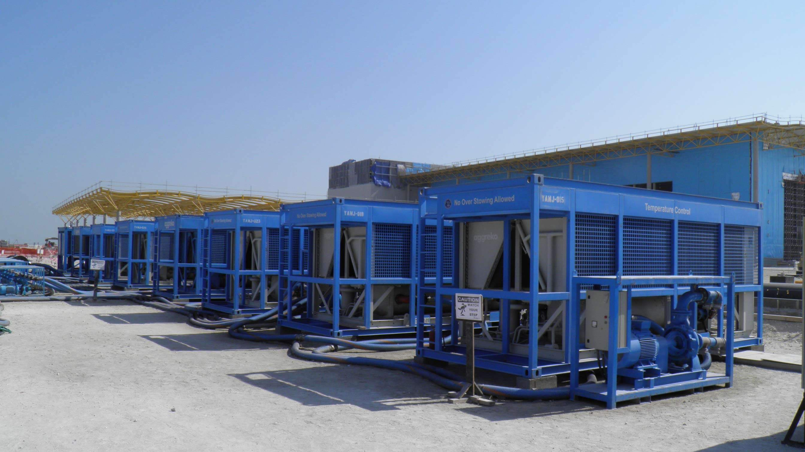 Row of Blue Aggreko Chillers in Oman