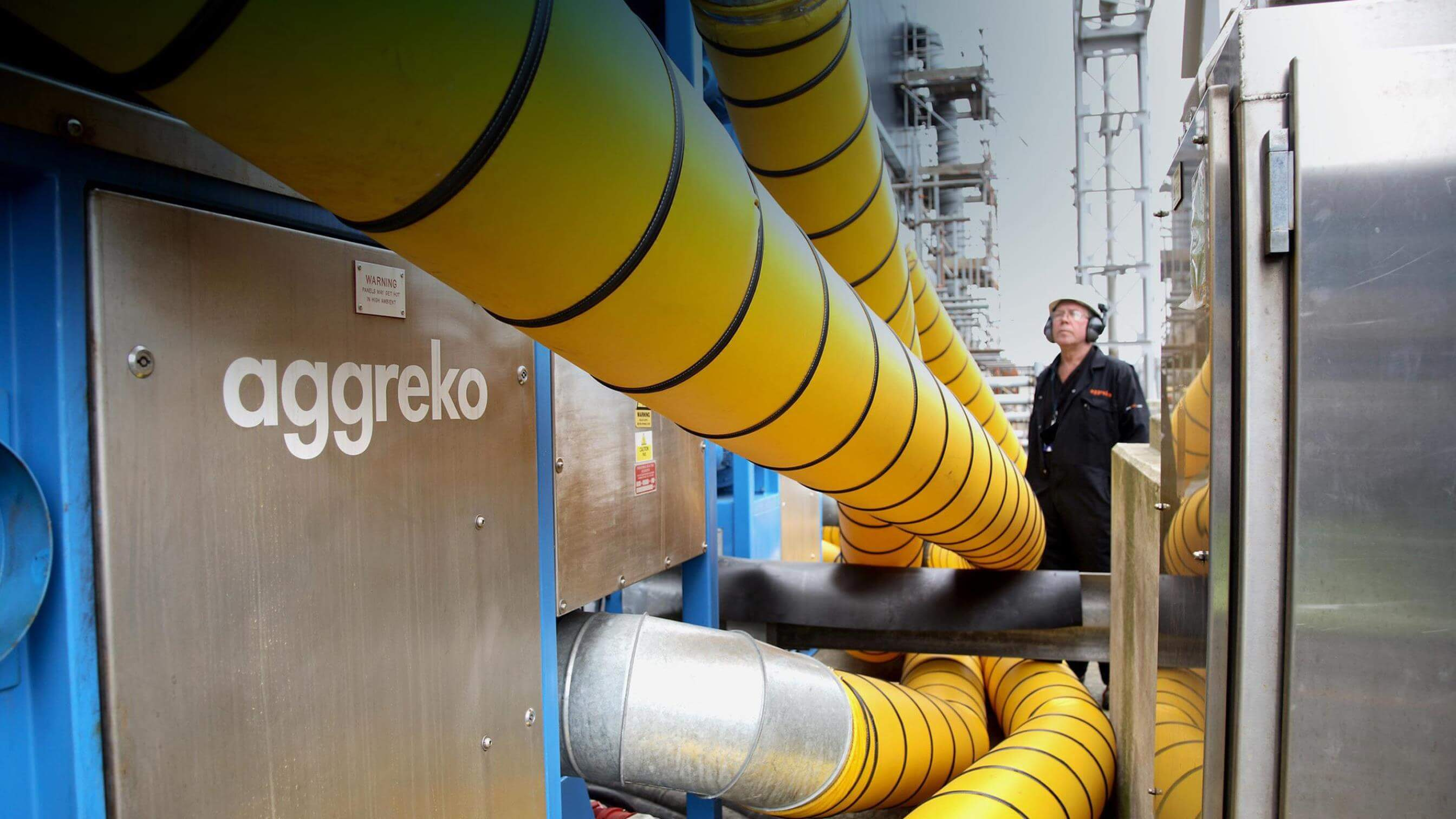 Aggreko technician at meat cutting plant testing chiller