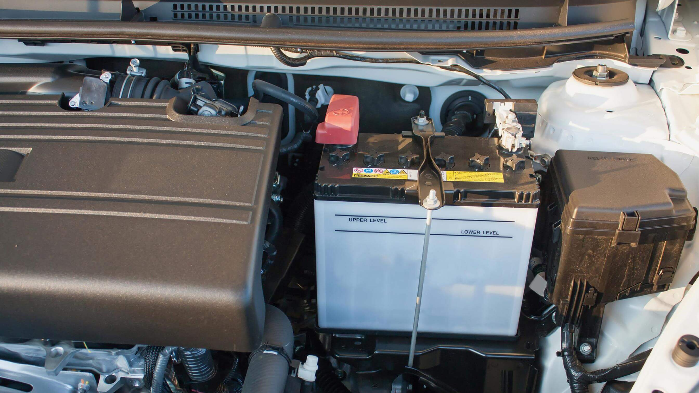 Car battery inside engine of car