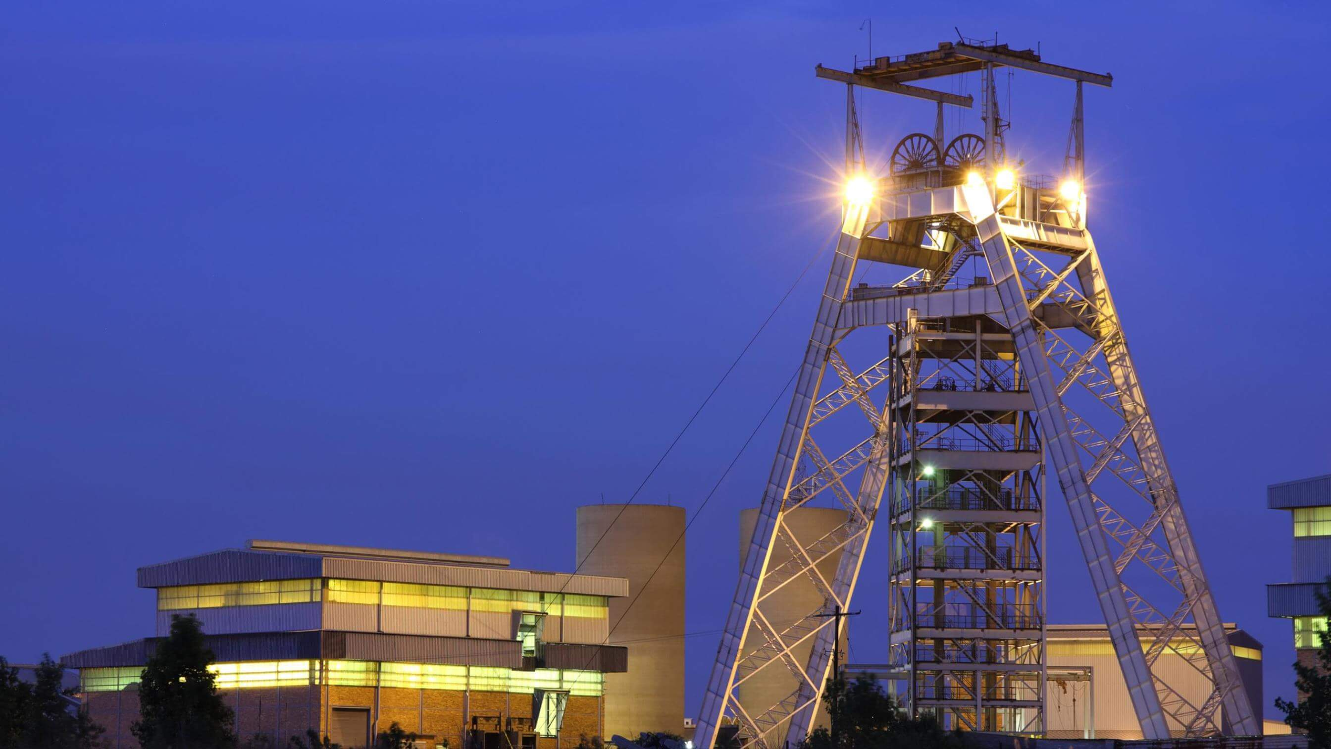 Gold mine pulley tower at night