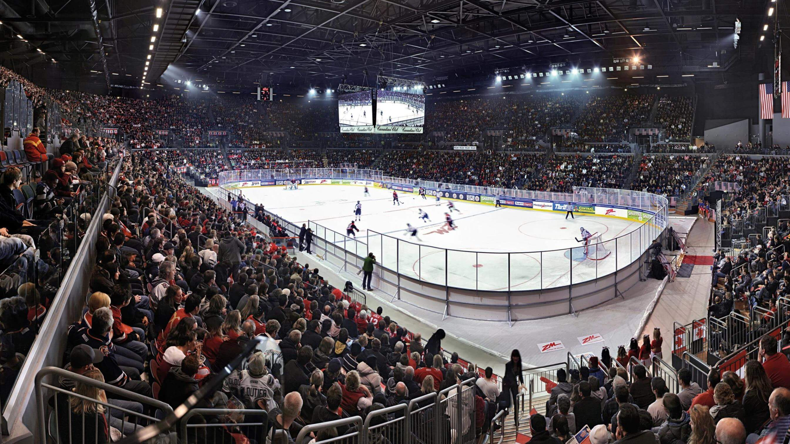 Ice hockey game being played in front of large crowd