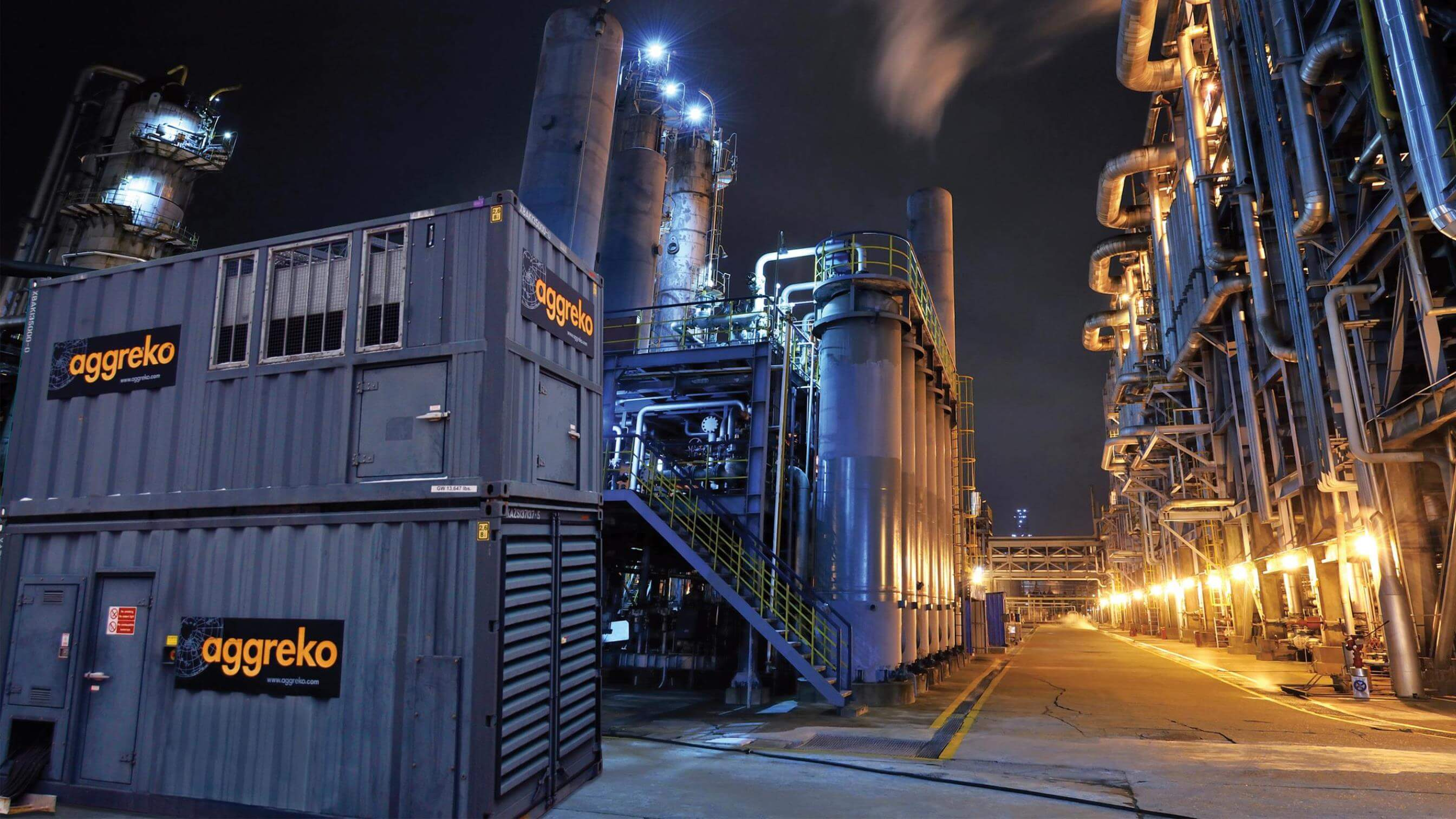 Natural gas generator at refinery at night