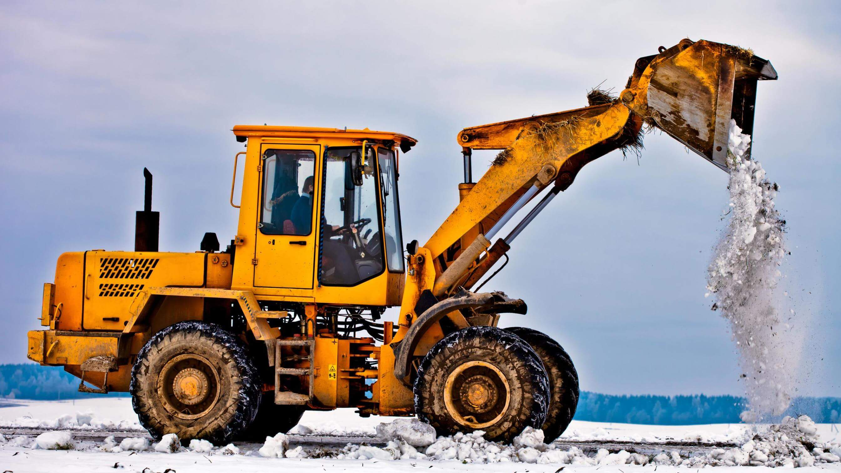 Wheel loader machine removing snow