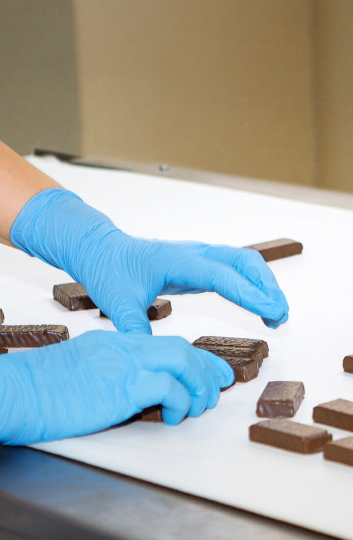 chocolates being arranged in a factory
