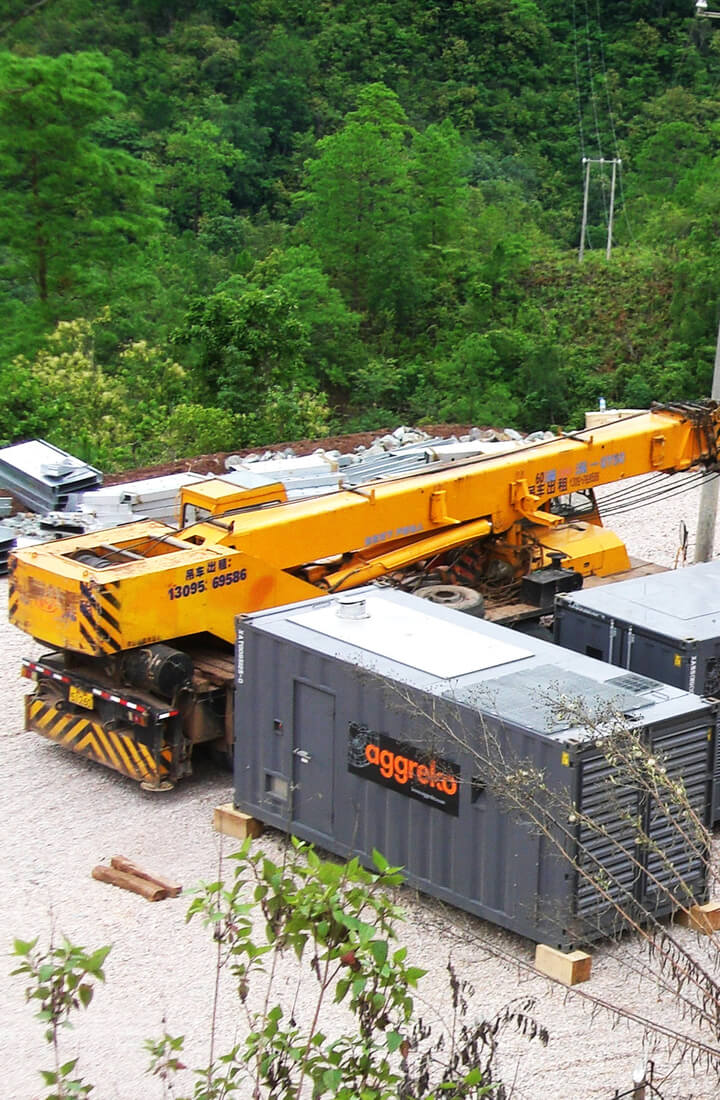 Crane near a row of generators