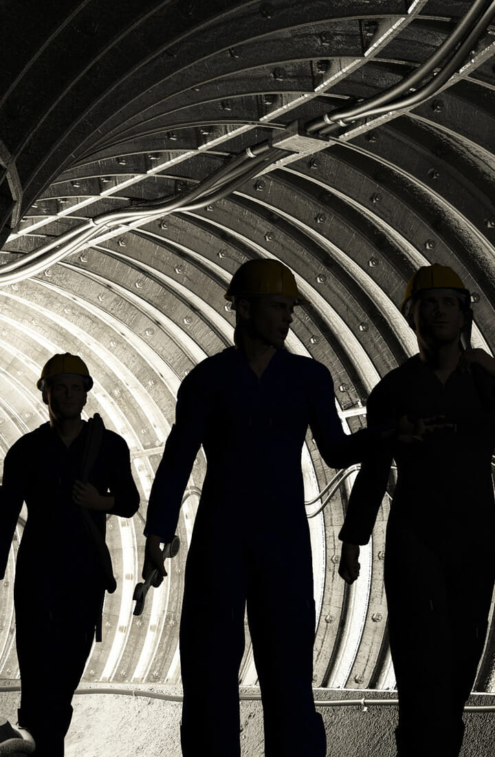 workers walking through tunnel