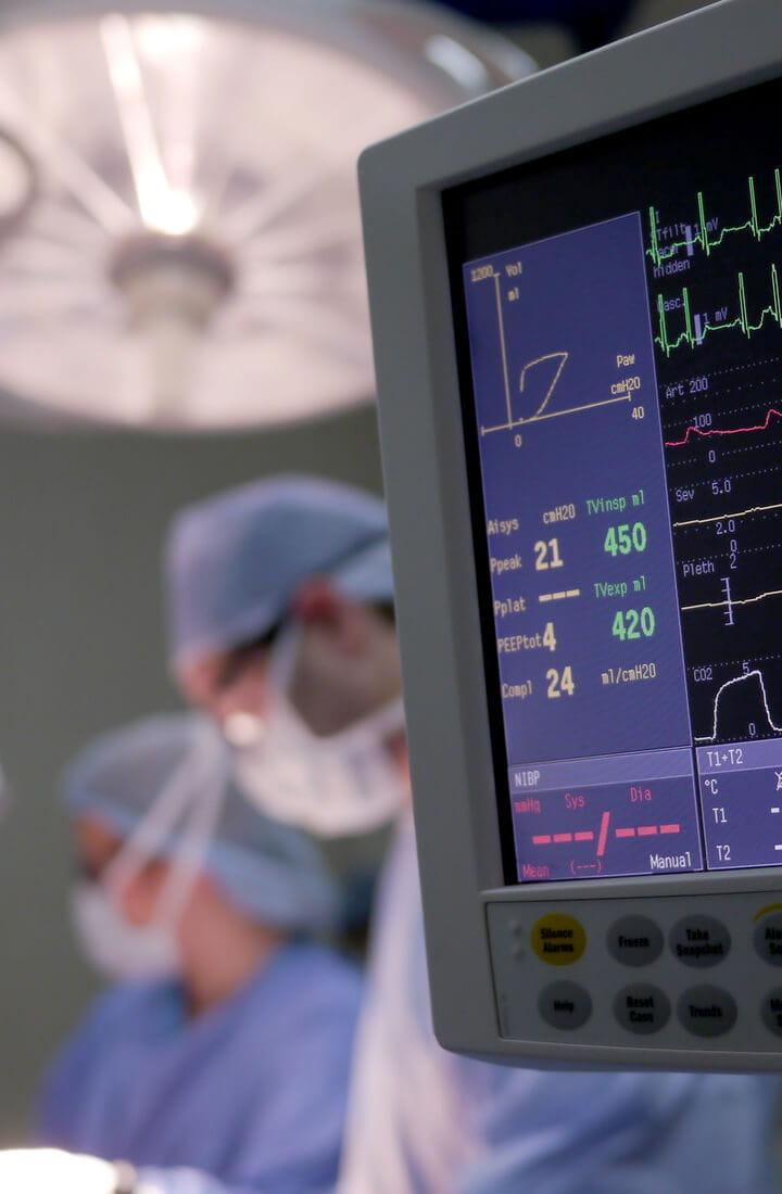 surgeons and surgical monitor