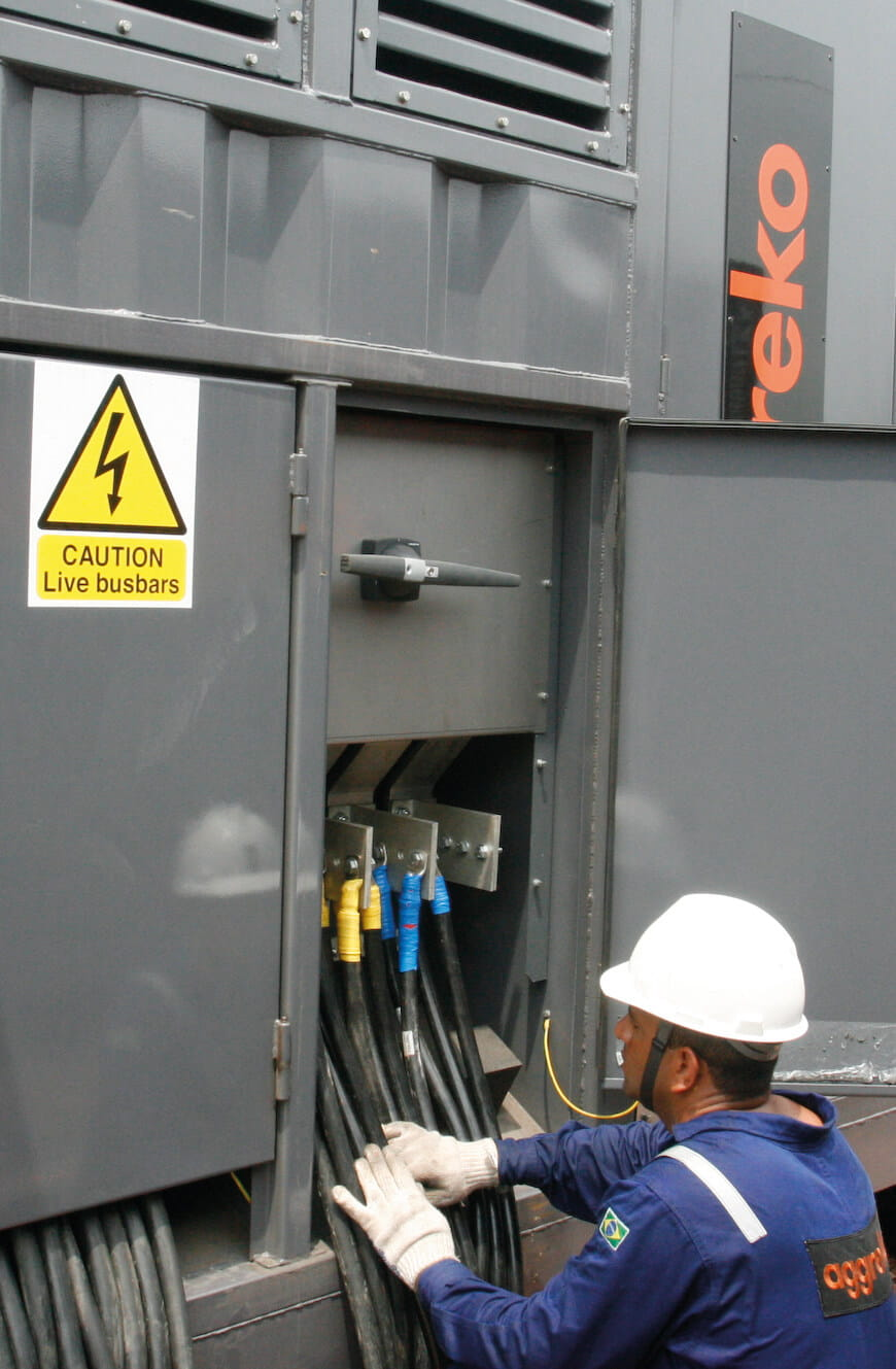 A technician working on an Aggreko loadbank
