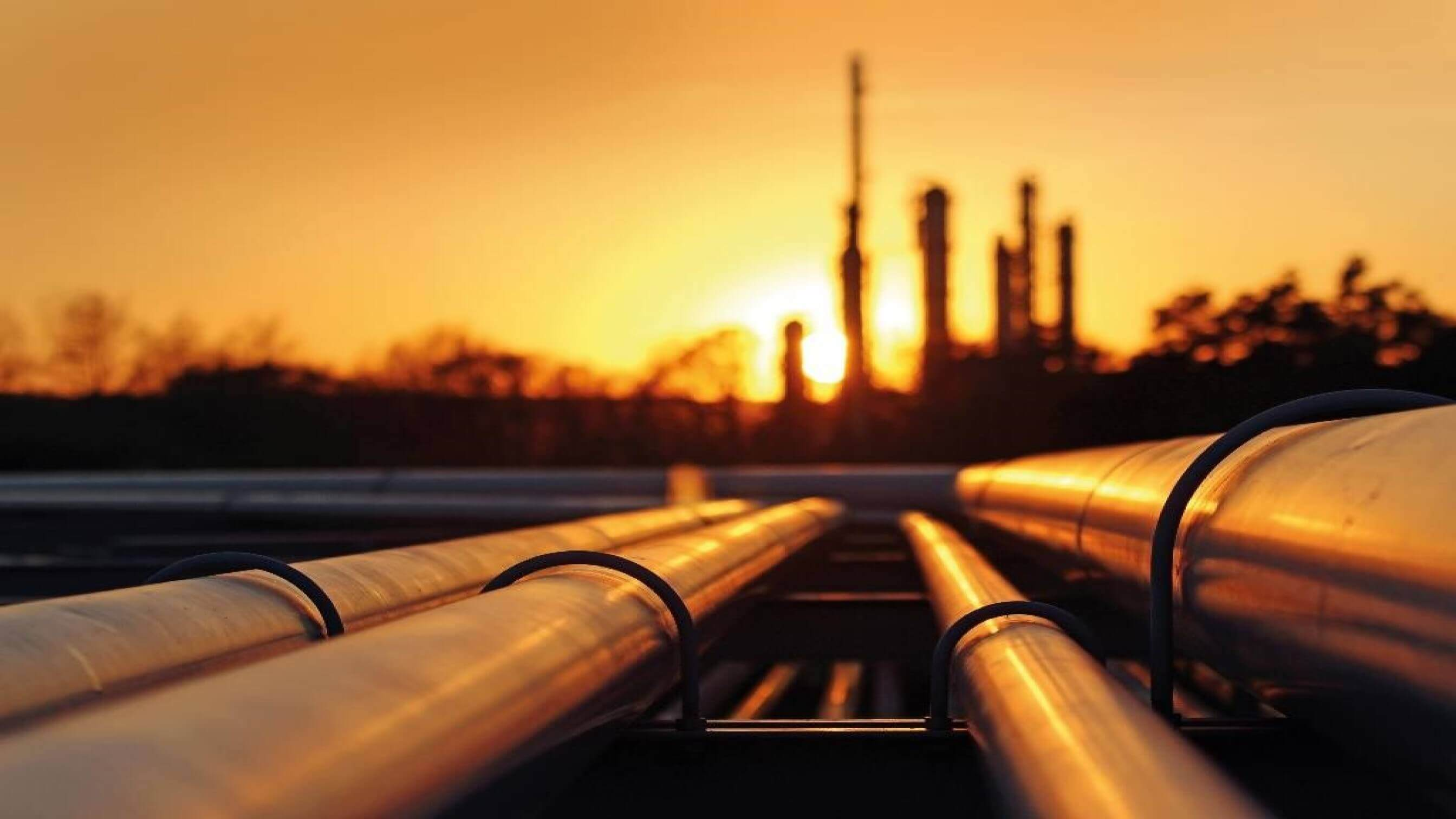 Refinery pipes at sunset
