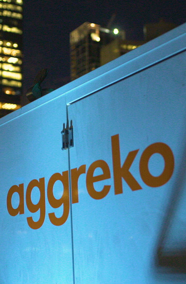 mobile image of Aggreko generator with city backdrop