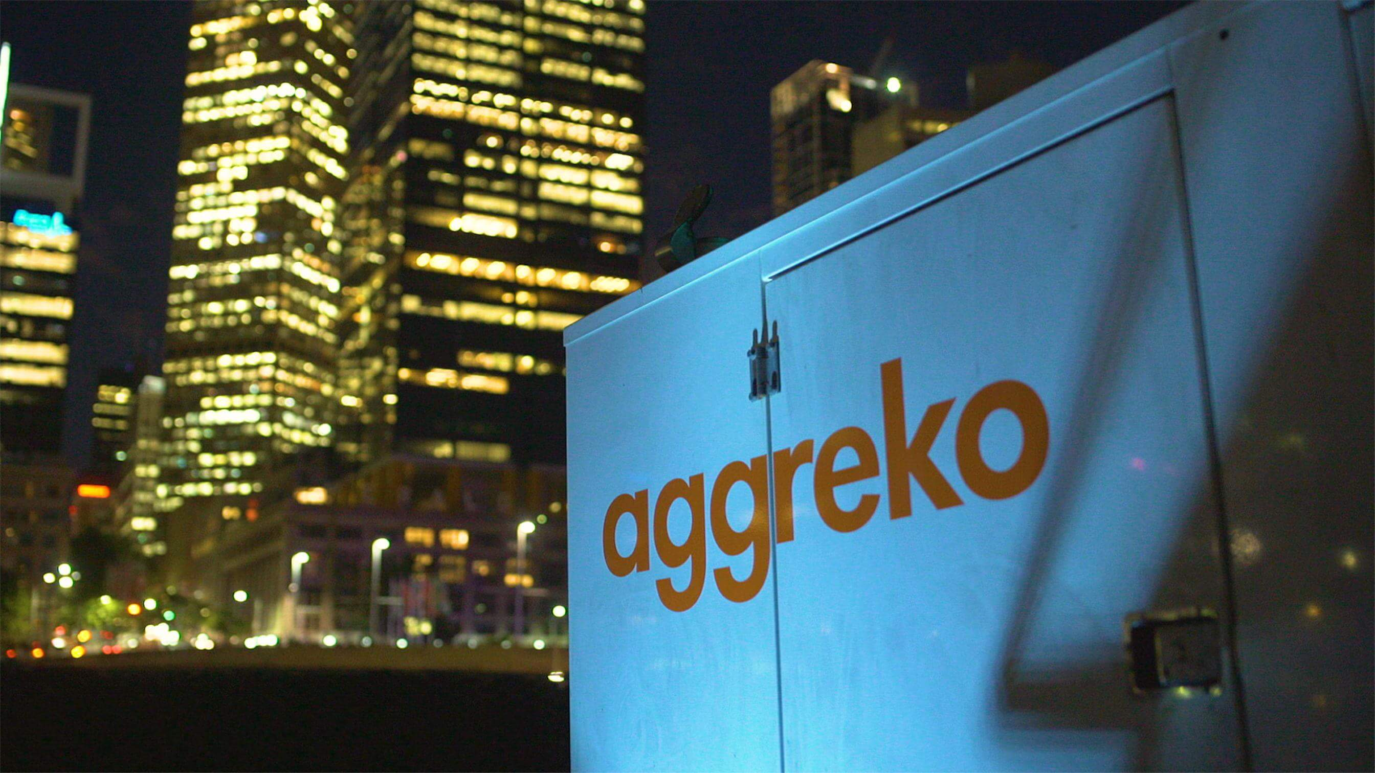 Aggreko generator with city backdrop