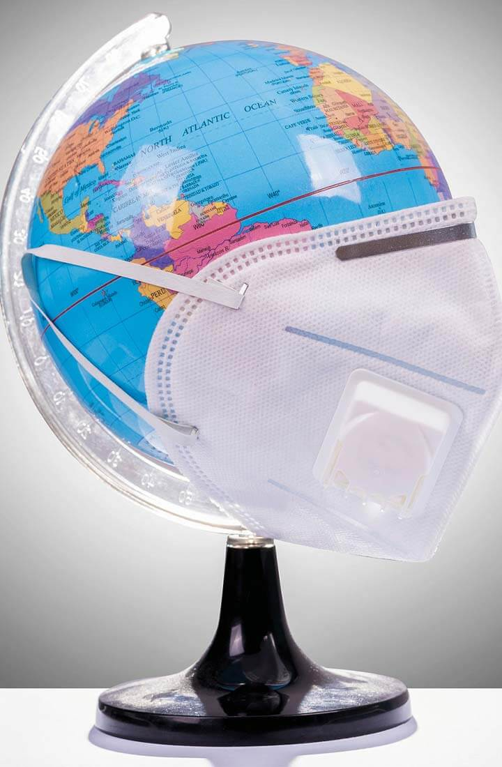 Globe with surgical mask on it