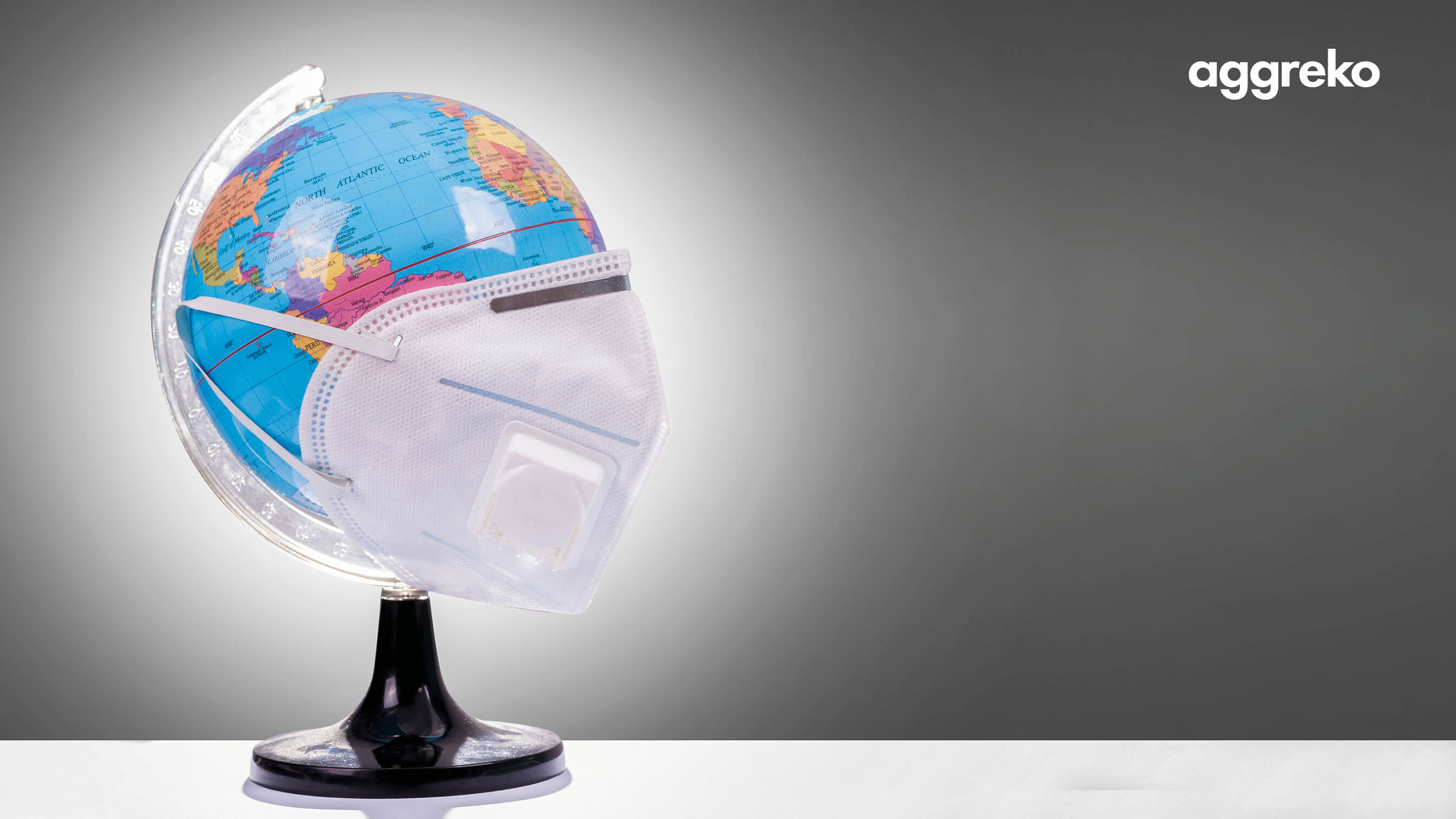 Globe of the world with a surgical mask on