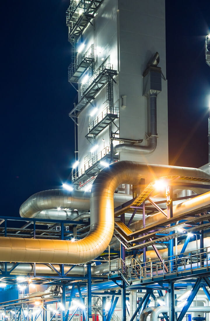 Refinery pipes at night