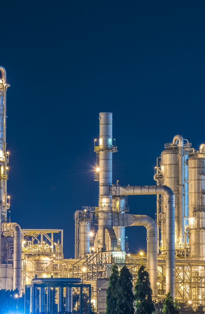 Refinery at night with dark blue sky
