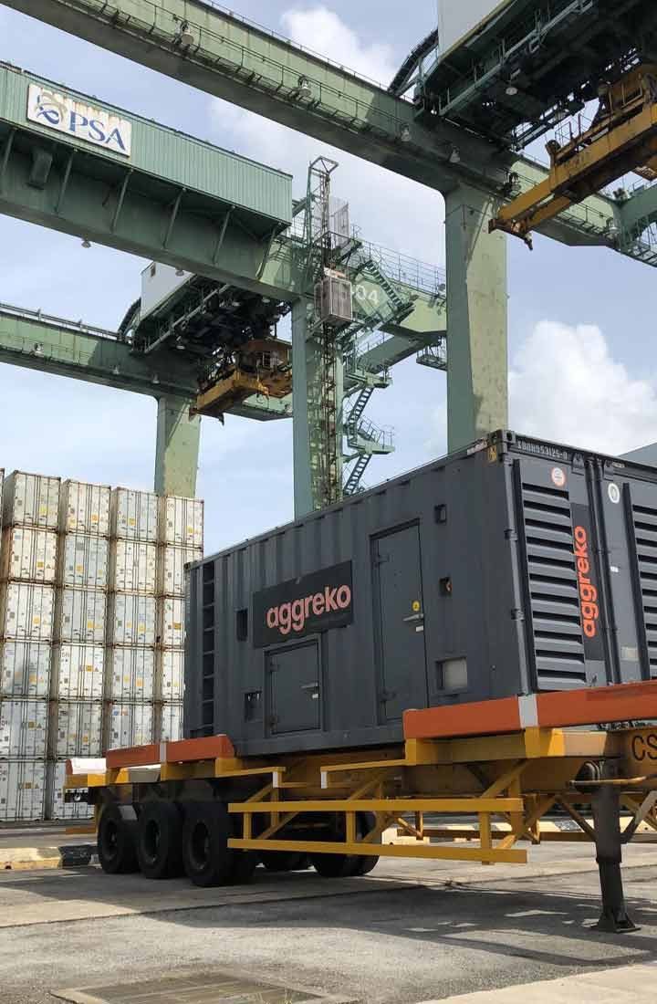Aggreko generator being lifted by a crane